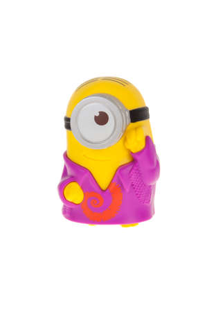 groovy: Adelaide, Australia - June 28, 2015: A Talking Groovy Minion Figurine issued with McDonalds Happy Meals in 2015. The toys are issued in conjunction with Happy Meal Purchases to promote the release of the Minion movie. Editorial