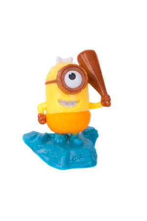 kinder: Adelaide, Australia - June 14, 2015: An isolated Minion Kinder Egg Toy photo. Kinder Surprise eggs are a popular treat for children and the toys contained inside are highly sought after collectables.