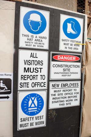 warning vest: Various construction warning signs at a site entrance