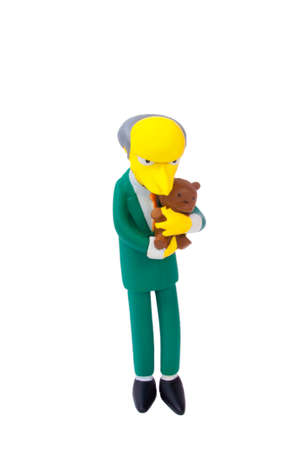 montgomery: Adelaide, Australia - May 04, 2015: An isolated image of a Montgomery Burns figurine. The Simpsons is the longest running animated TV series of all time. Items from the Simpson are highly sought after collectables. Editorial