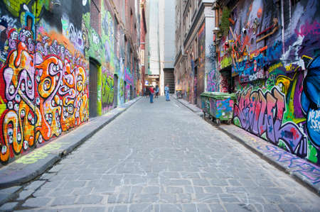 Melbourne, Australia - August 28, 2014: People visiting the famous Hosier Lane in Melbourne. The Laneway is full of street art from local and international artists and attracts many thousands of visitors.