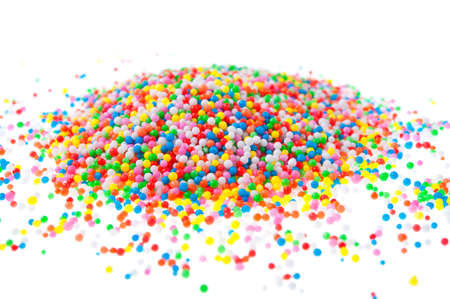 hundreds: A pile of hundreds and thousands sprinkles on a white background.