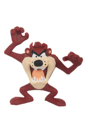 taz: Adelaide, Australia - June 8, 2015: A photo of a tasmanian devil figurine from Looney Tunes isolated on a white background. Looney Tunes is a popular childrens cartoon television series from Warner Bros.