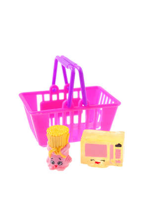 internationally: Adelaide, Australia - July 09,2015: A studio shot of a package of Shopkins. Shopkins are a popular range of girls toys which are Grocery Themed miniature characters.Made by Australian company Moose Toys and distributed internationally, with more 6 million Editorial