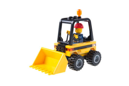 collectable: Adelaide, Australia - July 09,2015:A studio shot of a Construction Worker in a Tractor Lego minifigure from the Lego City series. Lego is extremely popular worldwide with children and collectors.