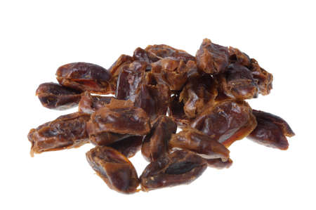 pitted: A pile of pitted dates isolated on a white background Stock Photo