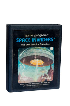 space invaders: Adelaide, Australia - February 06, 2015: A Studio shot of an Atari 2600 Space Invaders Game Cartridge. Originally available in the 1980s is now considered a collectors item.