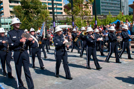 credit union: Adelaide, Australia - November 14, 2015: The Band of the South Australian Police in the annual credit union christmas pagaent. The parade is sponsored by South Australian Credit Unions and attracts over 300,000 people annually.