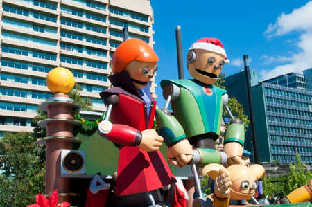 credit union: Adelaide, Australia - November 14, 2015: One of the floats in the annual credit union christmas pagaent. This particular float is entitled Robot Family Christmas. The parade is sponsored by South Australian Credit Unions and attracts over 300,000 people a