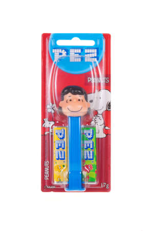 lucy: Adelaide, Australia - November 13, 2015: A Lucy Peanuts Pez dispenser isolated on a white background. Pez is an Austrian company famous for its candy and its character mechanical dispensers. The Dispensers are highly sought after collectables.
