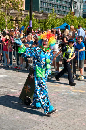 credit union: Adelaide, Australia - November 14, 2015: A Clown in the annual credit union christmas pagaent. The parade is sponsored by South Australian Credit Unions and attracts over 300,000 people annually.