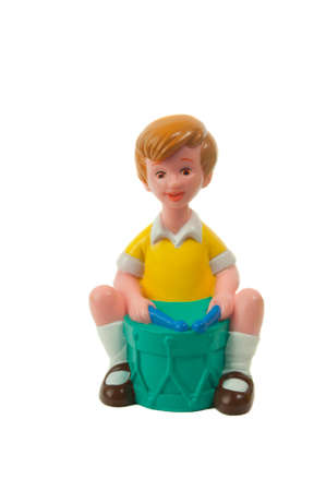 collectable: Adelaide, Australia - April 21, 2015: A Christopher Robin figurine isolated on a white background from the popular A. A. Milne Winnie the Pooh stories. Merchandise from Winnie the pooh are highly sought after collectables.