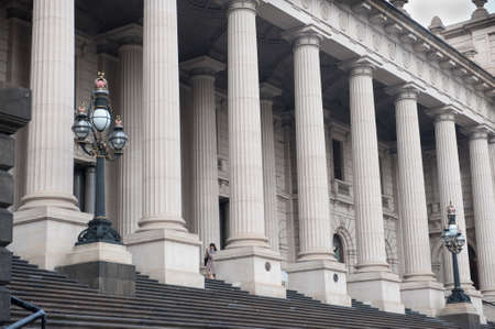 Melbourne, Australia - August 29, 2014: The steps and columns outside the entrance to the Victorian Parliament Building. The business of governing the state of Victoria is undertaken within this building. The steps and columns are a popular spot for weddi