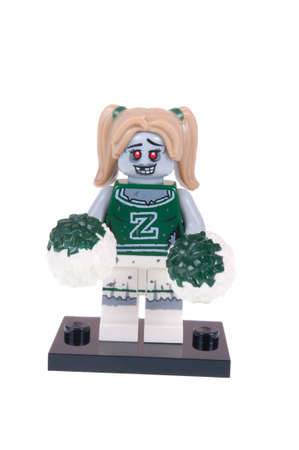 black cheerleader: Adelaide, Australia - October 26, 2015:An isolated shot of a Zombie Cheerleader Lego Minifigure from Series 14 of the collectable lego minifigure toys. Lego is very popular with children and collectors worldwide.