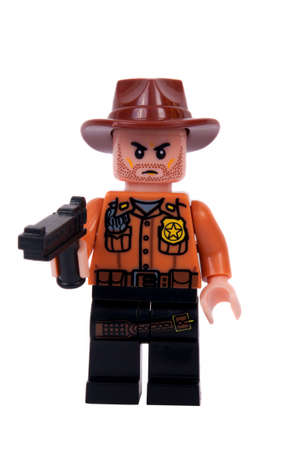 rick: Adelaide, Australia - June 19, 2015: A studio shot of a Rick Grimes Custom Lego minifigure from the Walking Dead. Lego is extremely popular worldwide with children and collectors.