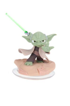 Adelaide, Australia - December 27, 2015: A studio shot of a Yoda Disney Infinity 3.0 Figurine from the Star Wars movies. Marvel comics and movies are extremely popular worldwide.
