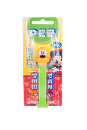 pluto: Adelaide, Australia - December 27, 2015: A Pluto Pez dispenser isolated on a white background. Pez is an Austrian company famous for its candy and its character mechanical dispensers. The Dispensers are highly sought after collectables. Editorial