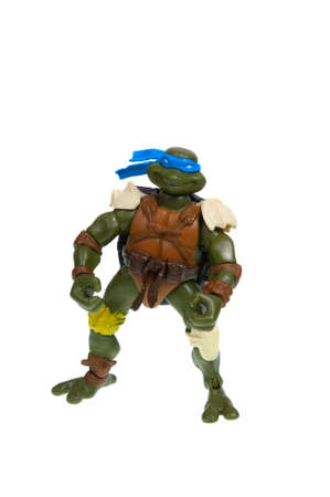 animated action: Adelaide, Australia - December 07, 2015: An isolated image of a Leonardo Action Figure from the Teenage Mutant Ninja Turtles. Teenage Mutant Ninja Turtles is a very popular animated and movie series with merchandise being highly sought after collectables.