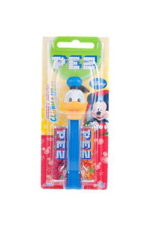 donald: Adelaide, Australia - December 27, 2015: A Donald Duck Pez dispenser isolated on a white background. Pez is an Austrian company famous for its candy and its character mechanical dispensers. The Dispensers are highly sought after collectables.
