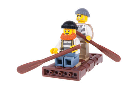 crook: Adelaide, Australia - October 26, 2015: A studio shot of a Crook Lego City minifigures on a raft from the popular Lego Series. Lego is extremely popular worldwide with children and collectors. Editorial