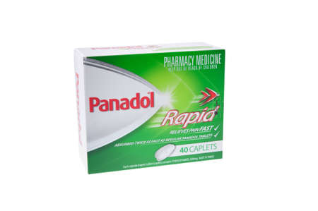 relieving pain: Adelaide, Australia - July 9, 2015: A box of Panadol Rapid isolated on a white background. Panadol is a popular paracetamol based pain relieving tablet within Australia. Used to treat headaches and other general pain relief.