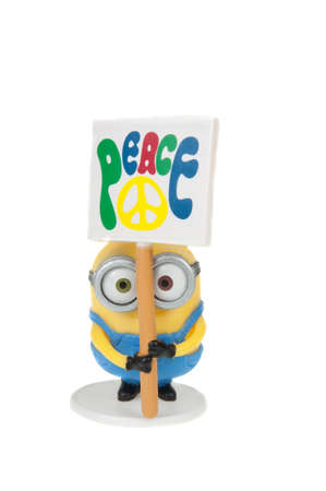 animated action: Adelaide, Australia - November 15, 2015: An isolated image of a Minion Action Figure from the animated movie Minions. Minions are a very popular animated characters from the despicable me and Minions movies with merchandise being highly sought after colle Editorial