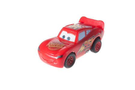 racing car: Adelaide, Australia - July 02, 2015: A Lightning McQueen Toy Car isolated on a white background. Lightning McQueen is the main character from the popular Disney movie Cars. Merchandise from movies are very popular with children and collectors worldwide.