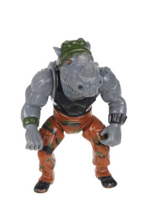 playmates: Adelaide, Australia - February 14, 2016: An isolated image of a Vintage Rocksteady Action Figure from the Teenage Mutant Ninja Turtles. Teenage Mutant Ninja Turtles is a very popular animated and movie series with merchandise being highly sought after col