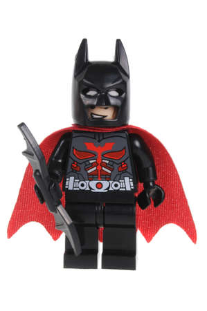 Adelaide, Australia - February 07, 2016: A studio shot of a Red Caped Batman Lego minifigure from the DC comics and movies. Lego is extremely popular worldwide with children and collectors.