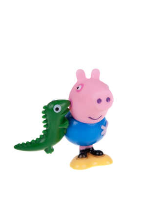 animate: Adelaide, Australia - December 25, 2015: A photograph of a George Pig Pig figurine isolated on a white background from the animated series Peppa Pig. Peppa Pig is a very popular animated series worldwide aimed at very young children. Editorial