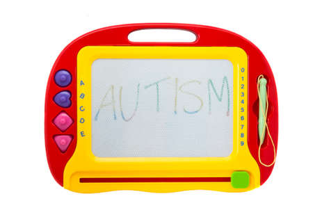 developmental disorder: An Erasable childrens drawing board isolated on a white background with the word autism