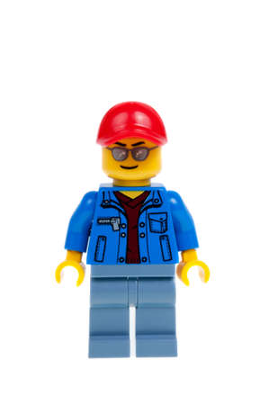 truck driver: Adelaide, Australia - December 07,2015:A studio shot of a Truck Driver Lego minifigure from the Lego City 60060 Auto Transporter kit. Lego is extremely popular worldwide with children and collectors.