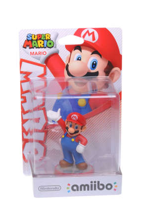 nintendo: Adelaide, Australia - February 23, 2016: A studio shot of a Mario Nintendo Amiibo Figurine.. This figurine is part of series released by Nintendo where placing the figure on the interface allows players to control that character in the game. Editorial