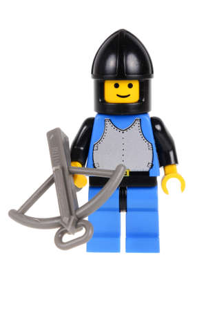 stronghold: Adelaide, Australia - February 21, 2016: A studio shot of a Black Knight Soldier Lego minifigure from the Lego Lego set 6059 Knights Stronghold issued in 1990. Lego is extremely popular worldwide with children and collectors.