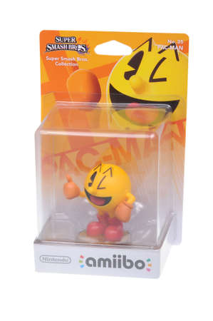 nintendo: Adelaide, Australia - February 23, 2016: A studio shot of a Pac-Man Nintendo Amiibo Figurine.. This figurine is part of series released by Nintendo where placing the figure on the interface allows players to control that character in the game.