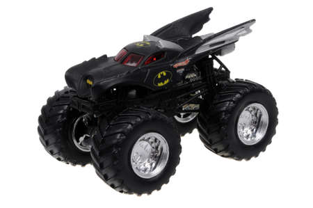 monster truck: Adelaide, Australia - March 15, 2016:An isolated shot of an unopened Batman Monster Truck Hot Wheels Diecast Toy Car from the DC Comics universe. Merchandise from DC Comics movies are highly sought after collectables. Editorial
