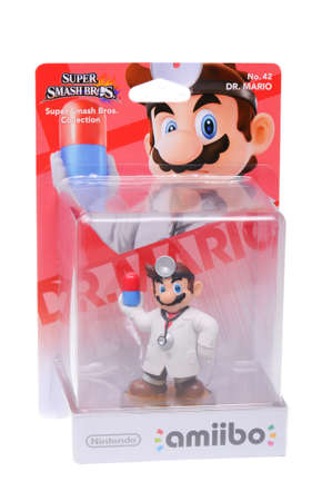 mario: Adelaide, Australia - February 23, 2016: A studio shot of a Dr. Mario Nintendo Amiibo Figurine. This figurine is part of series released by Nintendo where placing the figure on the interface allows players to control that character in the game.