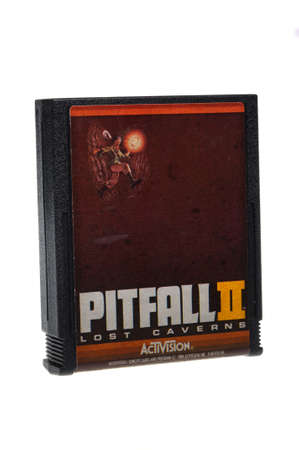 collectable: Adelaide, Australia - February 23 2016: A Studio shot of an Atari 2600 Pitfall II Lost Caverns Game Cartridge. A popular video game from the 1980s is popular with collectors and retro gamers worldwide.