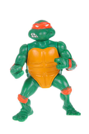 playmates: Adelaide, Australia - February 17, 2016: An isolated image of a Vintage Michaelangelo Action Figure from the Teenage Mutant Ninja Turtles. Teenage Mutant Ninja Turtles is a very popular animated and movie series with merchandise being highly sought after