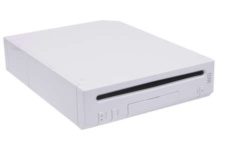 wii: Adelaide, Australia - March 15, 2016: A studio shot of a Nintendo Wii Console. A popular video game entertainment system sold worldwide since 2006 with over 100 million consoles sold.