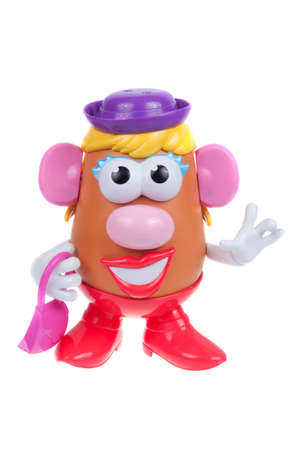 toy story: Adelaide, Australia - January 15, 2016: A Mrs Potato Head toy isolated on a white background. Mr Potato Head is a popular toy which has been in production since 1952. The toy has also appeared in Television series, the Toy Story Movies and video games.