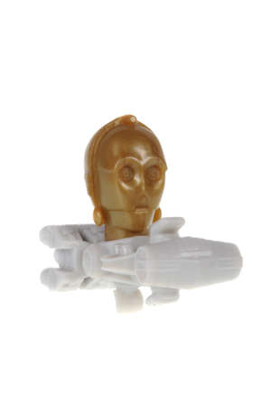 kinder: Adelaide, Australia - February 20, 2016: An isolated C-3PO Kinder Egg Toy photo. Kinder Surprise eggs are a popular treat for children and the toys contained inside are highly sought after collectables.