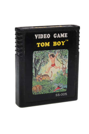 gamers: Adelaide, Australia - February 23 2016: A Studio shot of an Atari 2600 Tom Boy Game Cartridge. A popular video game from the 1980s is popular with collectors and retro gamers worldwide.