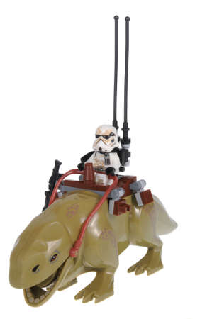 stormtrooper: Adelaide, Australia - February 19, 2016: A studio shot of an Sandtrooper riding a dewback Lego minifigure from the Star Wars Movie Series. Lego is extremely popular worldwide with children and collectors.