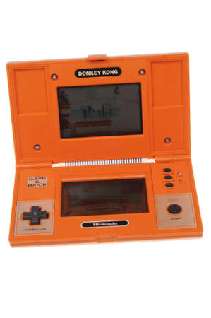 nintendo: Adelaide, Australia - February 23, 2016: A vintage Nintendo Donkey Kong Handheld Game isolated on a white background. Donkey Kong is one of Nintendos most popular games. Handheld games in working order from the 1980s are now highly valuable and sought a