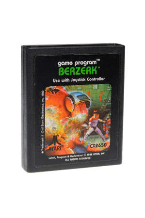 gamers: Adelaide, Australia - February 23 2016: A Studio shot of an Atari 2600 Berzerk Game Cartridge. A popular video game from the 1980s is popular with collectors and retro gamers worldwide.