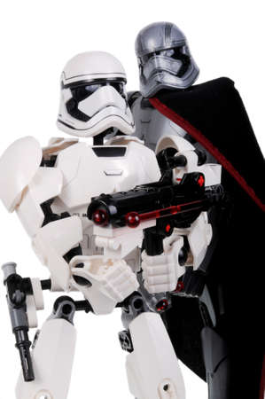 stormtrooper: Adelaide, Australia - February 18, 2016: A photo of a Lego Star Wars First Order Stormtrooper and Captain Phasma Buildable Lego Figures isolated on a white background. Lego and Star Wars merchandise are highly sought after collectables. Editorial