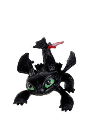 toothless: Adelaide, Australia - February 03, 2016: A Toothless Action Figure isolated on a white background from the popular How To Train Your Dragon series. Merchandise from the series are highly sought after collectables.