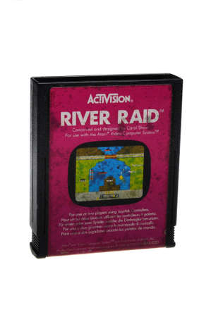 collectable: Adelaide, Australia - February 23 2016: A Studio shot of an Atari 2600 River Raid Game Cartridge. A popular video game from the 1980s is popular with collectors and retro gamers worldwide.
