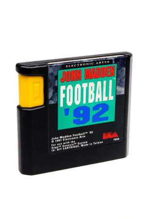gamers: Adelaide, Australia - February 23 2016: A Studio shot of a John Madden Footbal 92 Sega Genesis Game Cartridge. A popular video game from the 1990s is popular with collectors and retro gamers worldwide.